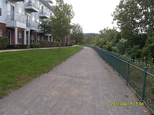 Great Allegheny Passage   Behind these apartment buildings is the trail but the surface changes to crushed limestone