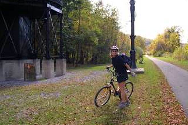 Greenbrier River Trail Trail Surface Variations About a 5-mile portion of the trail is paved near Marlinton, WV.  There's a well restored water tank and hardware at this rest area.