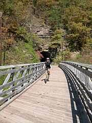 Greenbrier River Trail Tunnels and Trestles Tunnels with just enough bend in them so you need to creep in till you can see daylight.  Great trestles over the river.