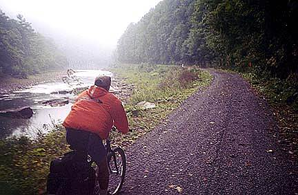 Greenbrier River Trail Riding in the morning fog Jeff Cobb riding along in the morning.