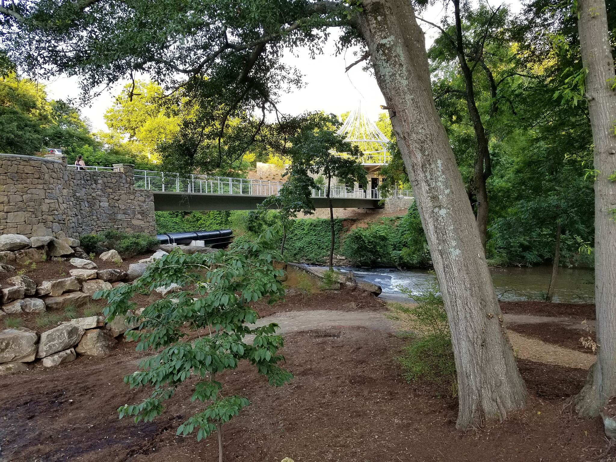 Greenville Health System Swamp Rabbit Trail New bridge over the Reedy At a newly built park along the trail just east of downtown.
