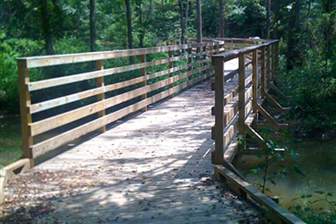 Greenville Health System Swamp Rabbit Trail Wooden Bridge This is one of the wooden bridges in the Conastee section of the trail.