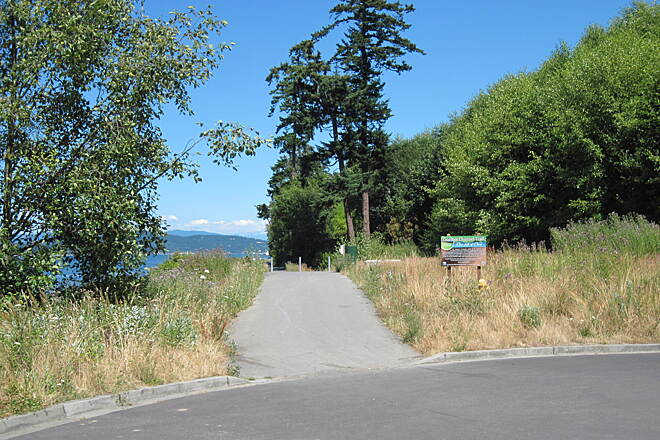 Guemes Channel Trail GUEMES CHANNEL TRAIL Start of the paved trail towards town.