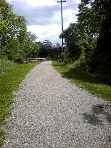Hanover Trolley Trail Hanover Trolley Trail - east segment Sloping west toward the trestle, which is just around the bend