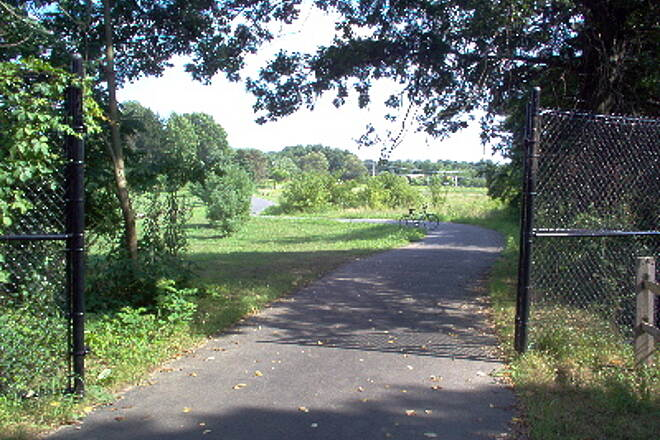 Henry Hudson Trail  Flood gates on trail north of Kosloski Rd., Freehold Twp. The black gates in the foreground are meant to be closed in the event the drainage basins on either side of the trail beyond the gates flood (this has yet to happen, but who knows?).