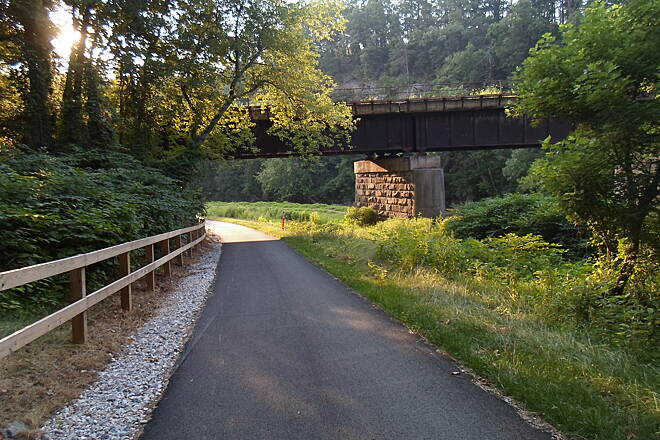 Heritage Rail Trail County Park Heritage Rail Trail Park The Northern Extension descends a gradual slope before passing under the Black Bridge Trestle. Taken June 2015.