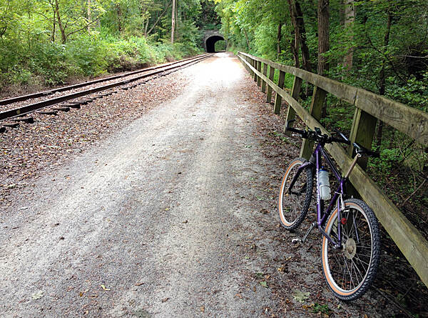 Heritage Rail Trail County Park Trail Ride Taking a break on my ride just before the tunnel. The surface on the trail is hard with some loose gravel, yet fairly smooth. Traveling by mountain bike or a hybrid would be the best choice for this ride. 30 miles on the trail down and back, a nice day.