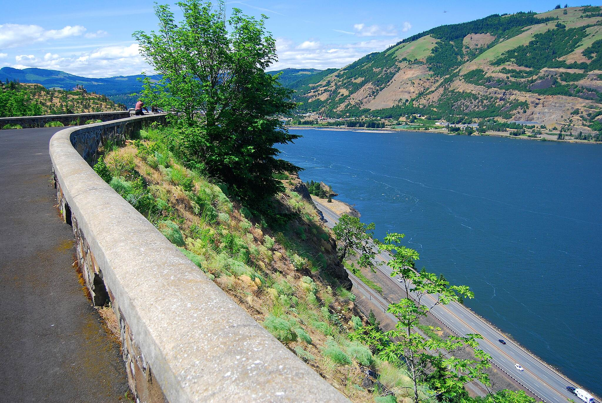 Historic Columbia River Highway State Trail Columbia River below what a view of the Columbia River and Highway 84 below the Hood River to Mosier Bike path.