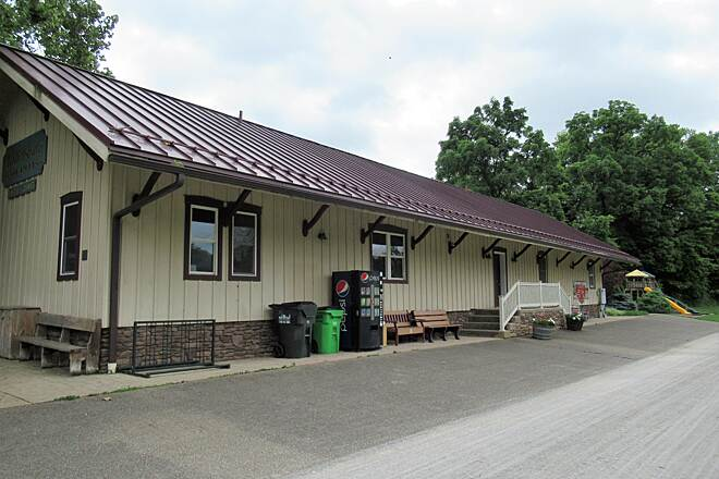 Holmes County Trail Former train station in Millersburg  Just on the edge of downtown Millersburg.  Large parking lot for 40-50 cars.