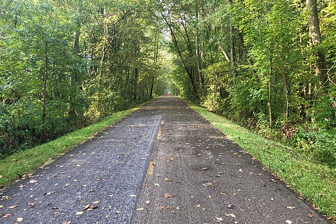 Holmes County Trail Is This a Trail or a Runway? The Holmes County Trail between Millersburg and Killbuck is wide, straight and tree-covered.  The extra width of this trail allows cyclists to ride the trail without having to stop and give Amish buggies the right to pass.  October 2019