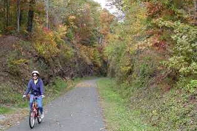 Huckleberry Trail Fall colors on Huckleberry Trail  -  Oct 2002 Near the more rural Christiansburg end, the trail goes through ridge cuts and woods.