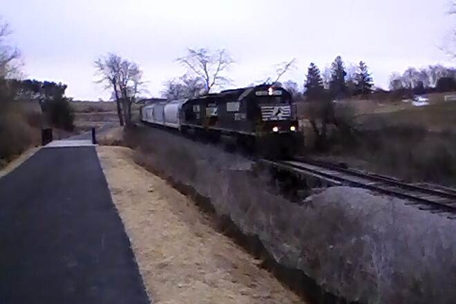"Huckleberry Trail Train along new extended ""rail with trail"" section NS local to Corning plant from Mall's movies parking area."