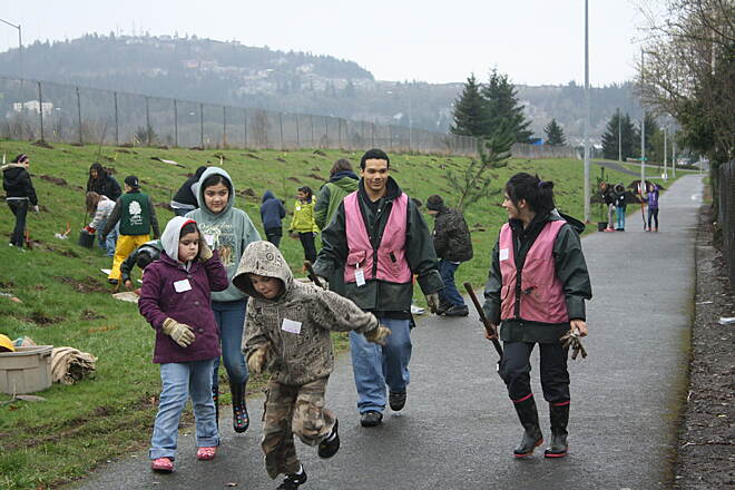 I-205 Multi-Use Path Friends of Trees Planting  On March 18, 2011, Portland Trail Blazer Marcus Camby & his daughter helped Boys & Girls Club members plant 25 trees at a Friends of Trees event along the I-205 Multi-Use Path in the Lents neighborhood. Photo by Greg Tudor. www.FriendsofTrees.org