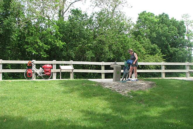 Illinois & Michigan Canal State Trail I&M Canal Path Cyclists along the path at a water fountain