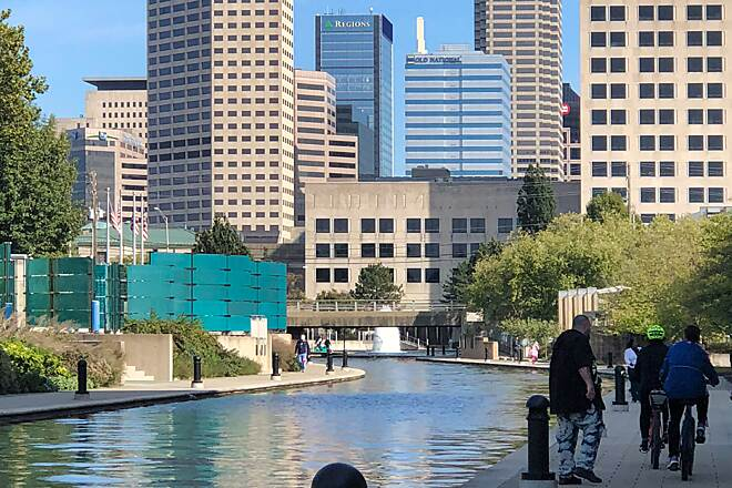 Indianapolis Cultural Trail The Promenade Part of the Cultural Trail includes the walkway around the Indiana Central Canal.  Bikes are not prohibited, but are not recommended in this busy area.  October 13, 2018.