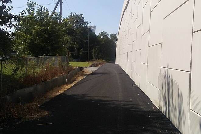 Industrial Track Greenway Trail Industrial Track Greenway Trail The new segment of trail runs along the retaining wall immediately south of I-295 for about a quarter mile. As of Sept. 2017, the tunnel that will take the trail beneath the highway is open to the public, but has not yet been paved or lit.