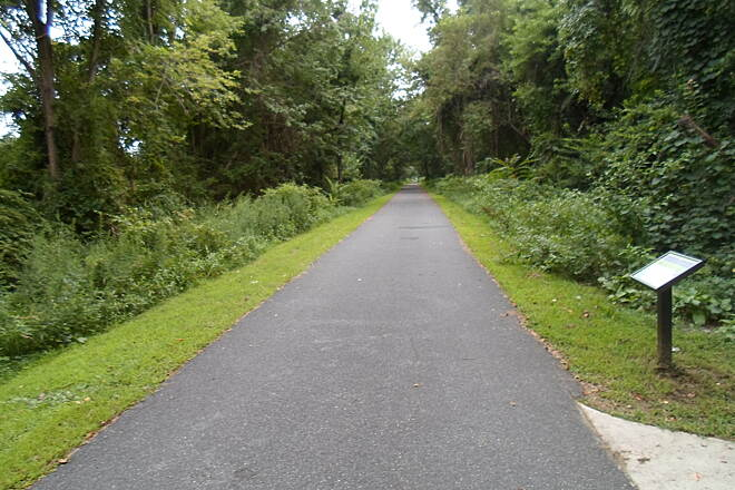 Industrial Track Greenway Trail New Castle Industrial Track Forest canopies create a 'green tunnel' effect on the completed, southern portion between Boulen Blvd. and Route 273. This provides cool shade on hot, summer days. Taken August 2014.