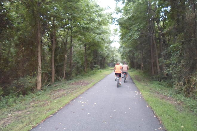 Industrial Track Greenway Trail New Castle Industrial Track Passing cyclists approaching Route 273.
