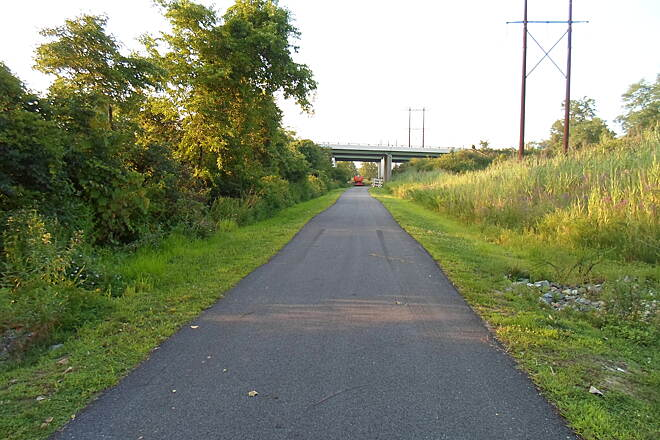 Industrial Track Greenway Trail New Castle Industrial Track Approaching the underpass that carries the trail beneath I-495. There was visible construction work being done here, as there was on other portions of the trail, in the summer of 2014.