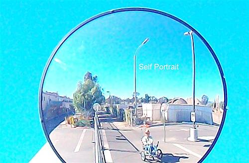 Inland Rail Trail Escondido-San Marcos Inland ]Rail Trail Twirlymaker in traffic Mirror at Transit-Maintence crossing.