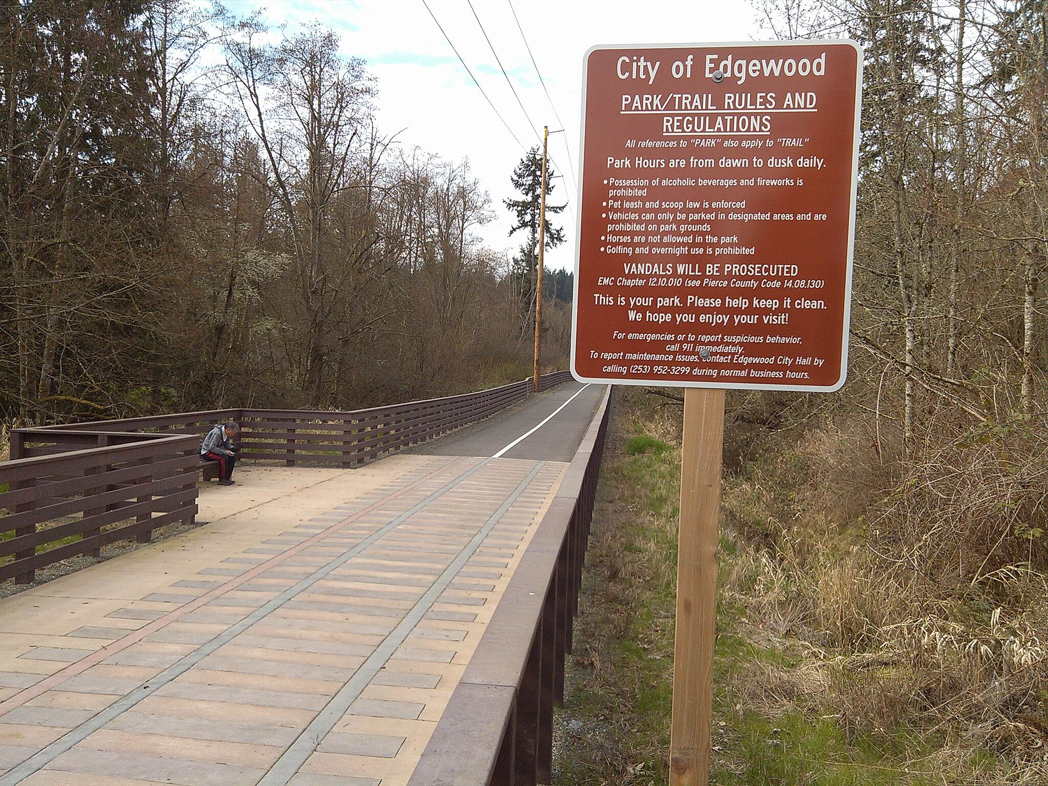 "Interurban Trail (South) Edgewood Trail segment with inlaid ""tracks and ties"" Looking west from the Edgewood Trailhead at 20 114th Avenue East"