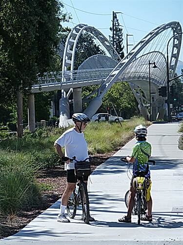 Iron Horse Regional Trail Rail Trail bridge across Treat Blvd. Two cyclists admire the recently completed bridge across Treat Blvd.