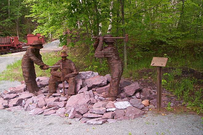 Iron Ore Heritage Trail Mining Sculpture  Sculpture in Negaunee at the Jackson Mine Pit #1 (first iron mine in the region). Photo courtesy of Iron Ore Heritage Trail.