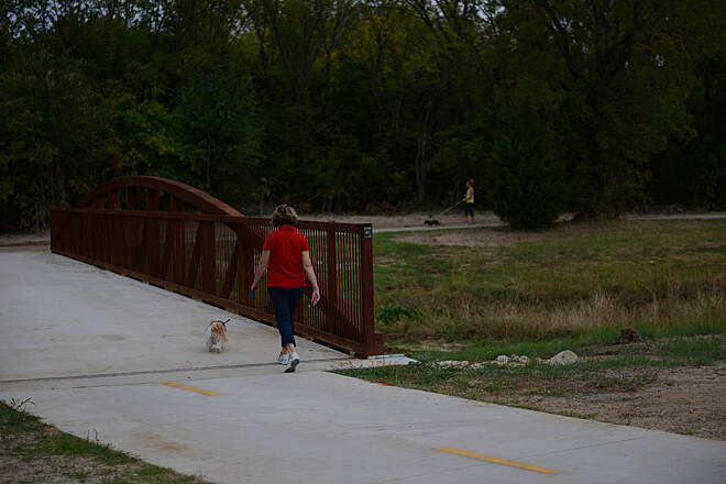 John Barfield Trail Dog walking on the trail. Photo courtesy of the City of North Richland Hills Parks and Recreation.