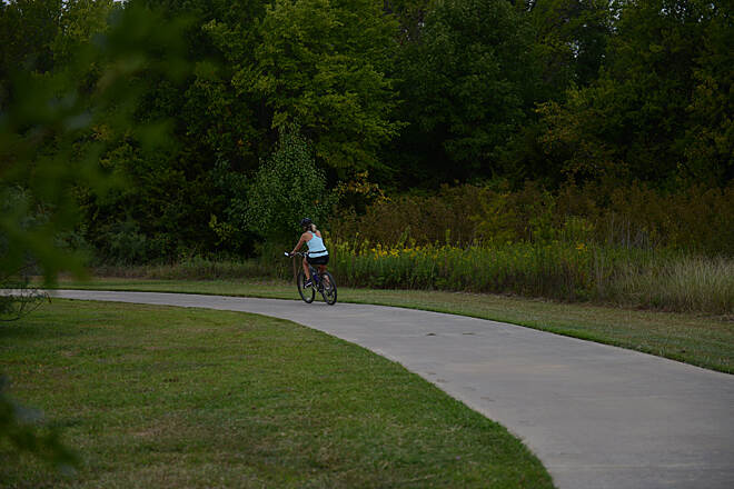 John Barfield Trail Biking on the paved pathway. Photo courtesy of the City of North Richland Hills Parks and Recreation.
