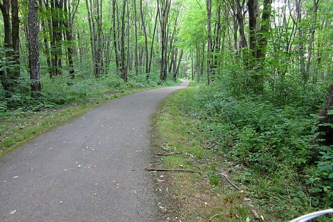 John C. Oliver Multi-Purpose Loop Trail Wooded area of the trail Wide trail through the wooded section of the trail.