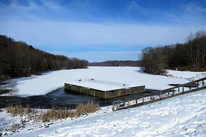 John C. Oliver Multi-Purpose Loop Trail the Dam-January 2019 Skim coat of ice on the lake and a new blanket of snow across the dam.  January, 2019