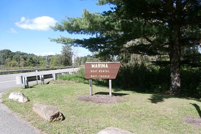 John C. Oliver Multi-Purpose Loop Trail Marina Sign Marina Sign.  Go through the parking lot to access the trail