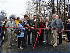 Joseph B. Clarke Rail Trail Dedication Of Clarke Trail Pedestrian Bridge J. B. Clarke Rail-Trail Opening The pedestrian bridge over Route 303 in Orangeburg was dedicated in a ribbon cutting ceremony held on November 30, 2006. The bridge links sections one and two of the Joseph B. Clarke Rail Trail. The Trail begins at Oak Tre