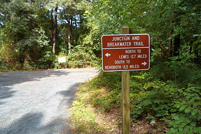 Junction & Breakwater Trail Junction & Breakwater Trail Sign at the intersection of the Wolfe Neck branch path and main trail, indicating the distance north to Lewes and south to Rehoboth. Taken August 2014.