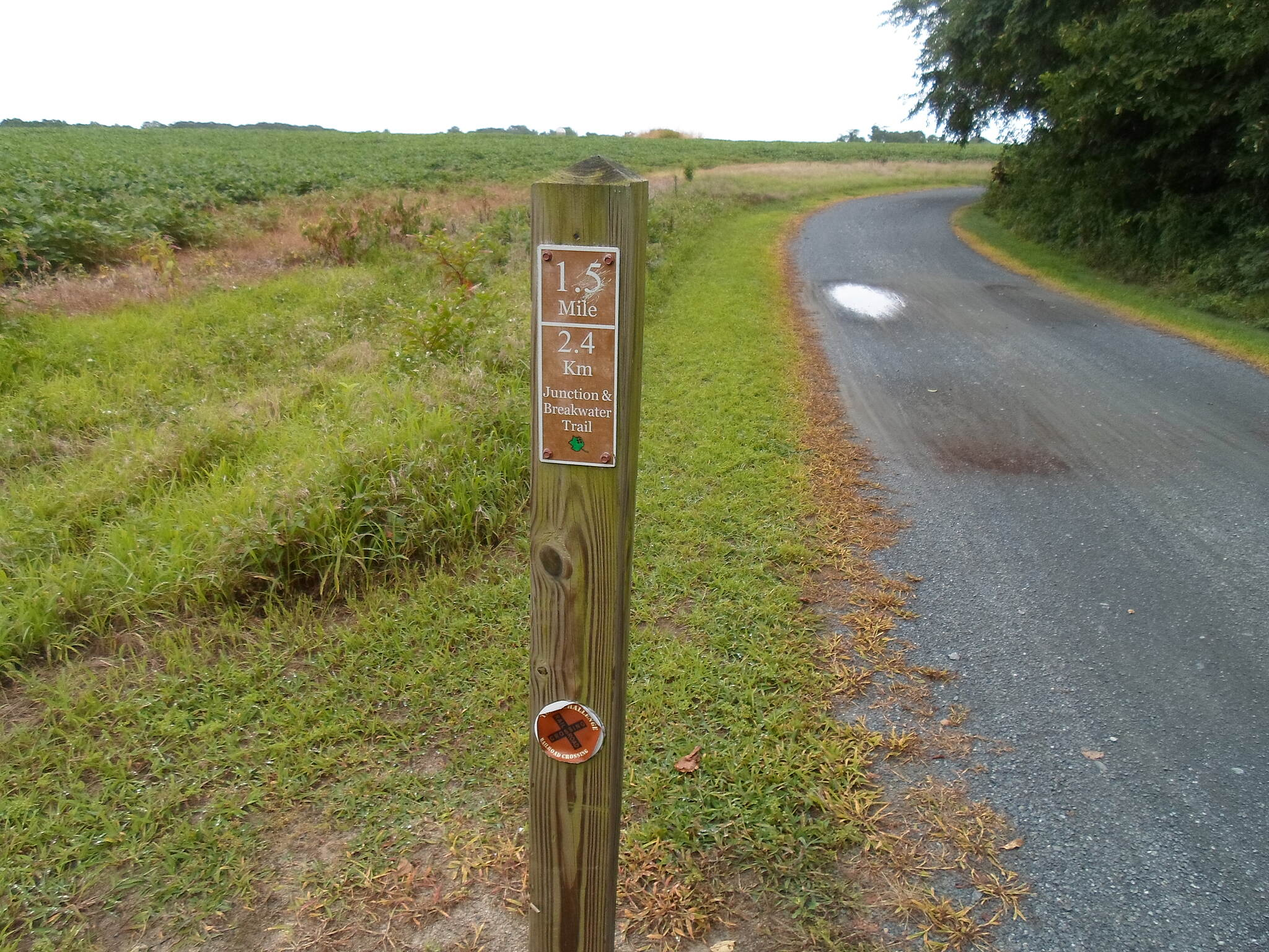 Junction & Breakwater Trail Junction & Breakwater Trail Milepost on the section that skirts the farm near Midway.