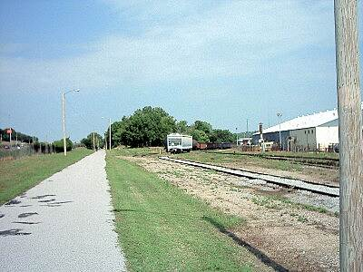 KATY Trail (Tulsa) Trail and Active Railway Here is a shot of the trail and the neighboring Sand Springs Railway. This is typical of the western end of the trail in the Sand Springs area.