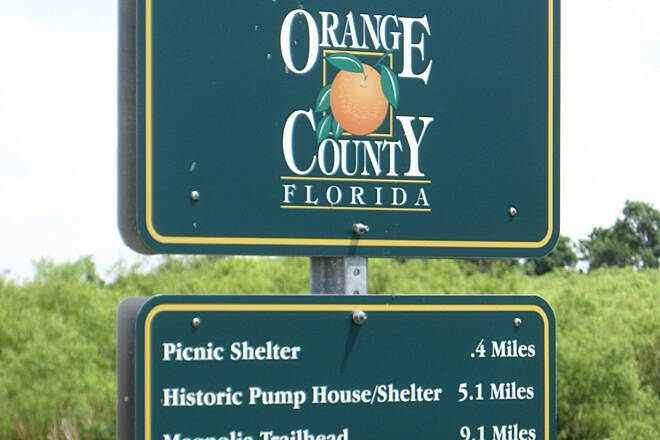 Lake Apopka Loop Trail County Line Marker 'Welcome to Orange County.'