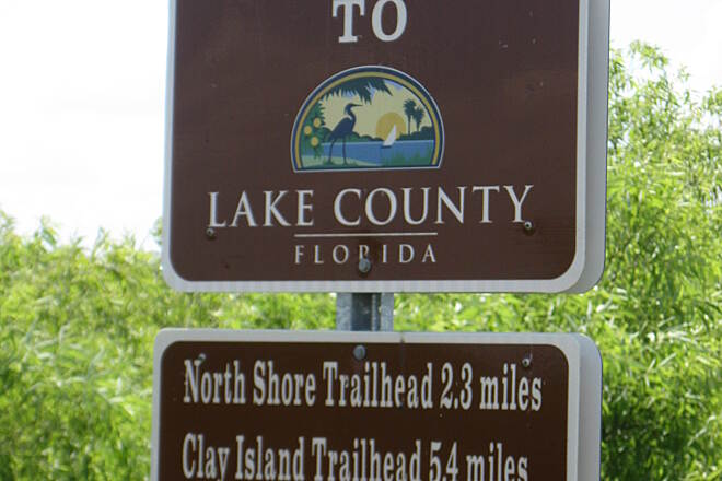 Lake Apopka Loop Trail County Line Marker. 'Welcome to Lake County.'