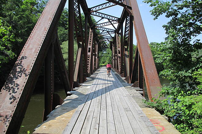 Lamoille Valley Rail Trail LVRT: Morristown to Cambridge Be Careful until the total trail construction is completed!  This bridge crossing has planks with spacing that can easily swallow a tire!  AND take a look, there are no guard rails yet!  Watch your young kids until the trail is completed!