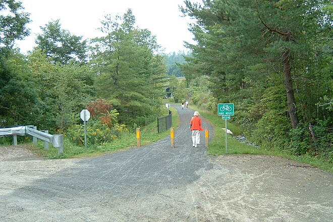 Lamoille Valley Rail Trail The trail in St. Johnsbury. Photo by Bob Youker. It's taken at the start of the parking lot in St. Johnsbury with the tunnel under the interstate just visible at the top of the photo.