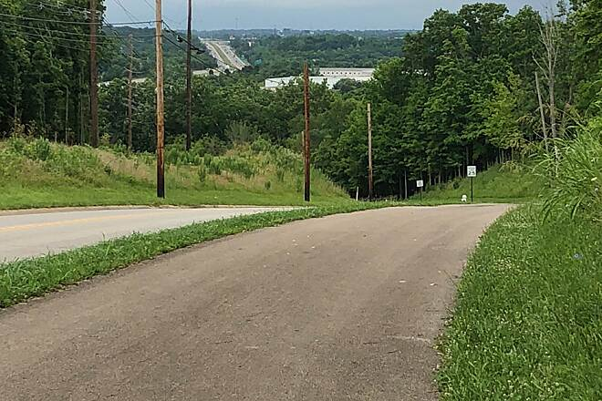 Lebanon Countryside YMCA Trail Quick Descent The trail drops into the Little Miami River Valley along Kingsview Drive.  The trail crosses under I-71 (seen in the background) before connecting with the Little Miami River Trail.