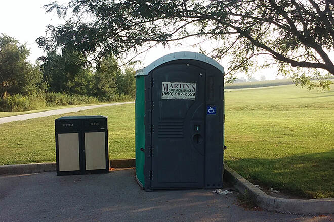 Legacy Trail (KY) Aug 2015 Ground level ADA portable toilet at Coldstream Bottom parking lot