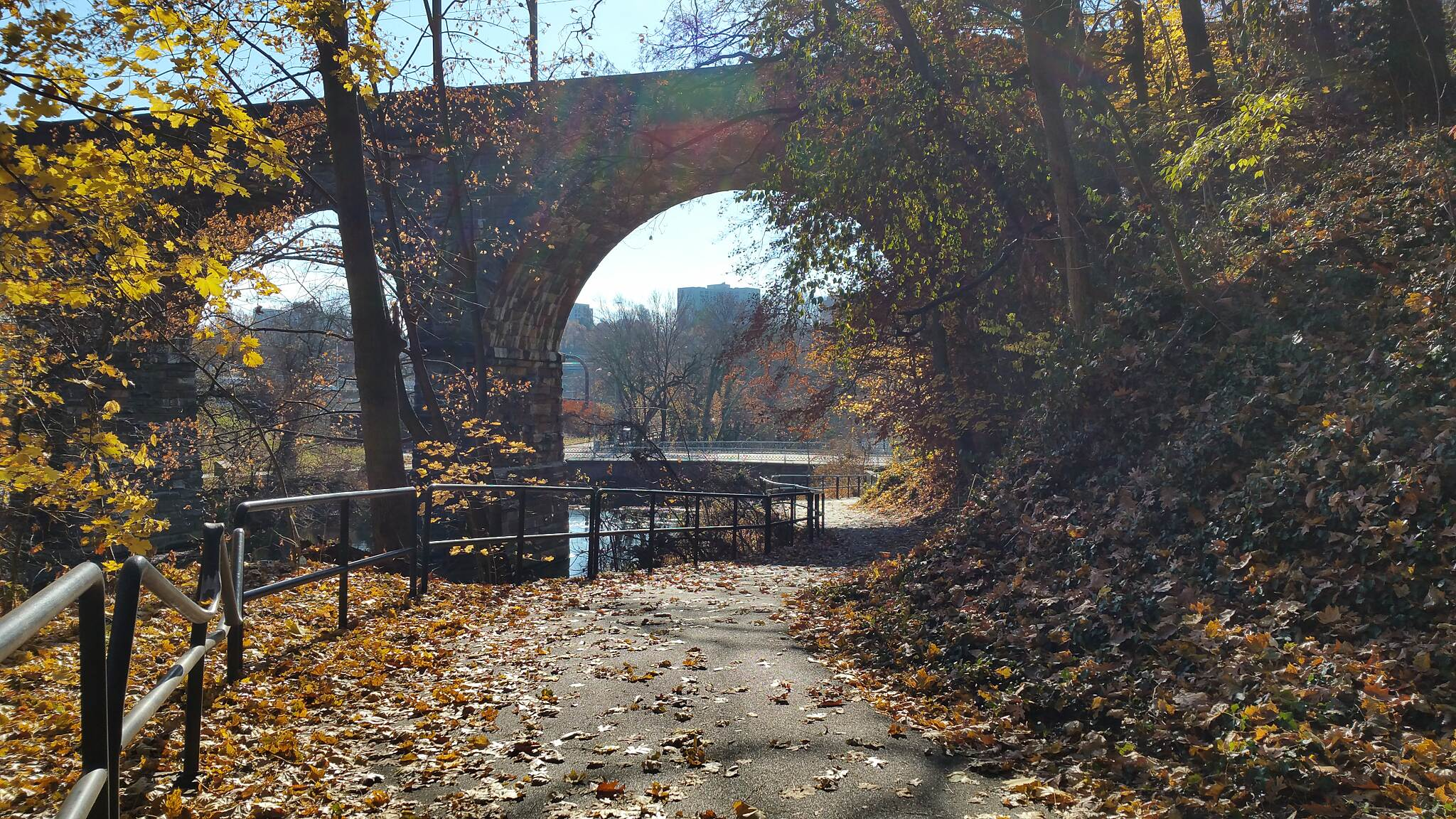 Lincoln Drive Trail  The Winding Trail  The photo is more fall like then an early December day. The bridge is the old Reading Railroad and Ridge Ave. is in the background. Cross over Ridge Ave. make a left go about 50 ft. and make a hard right, you will run into Schuylkill River Nature Trail.
