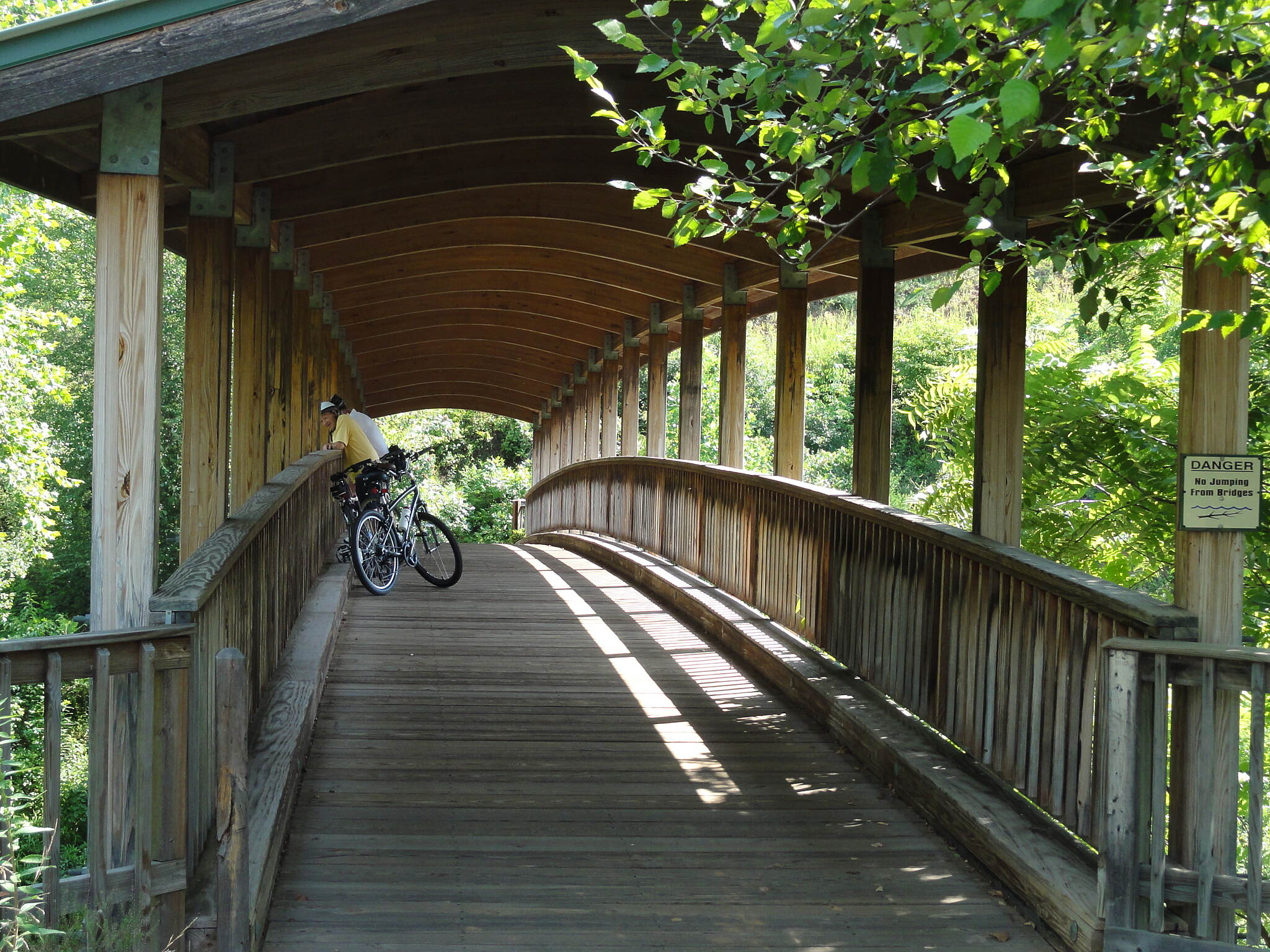 Little Tennessee River Greenway (Franklin) Cyclists Pause Midbridge One of several picturesque bridges on this trail.