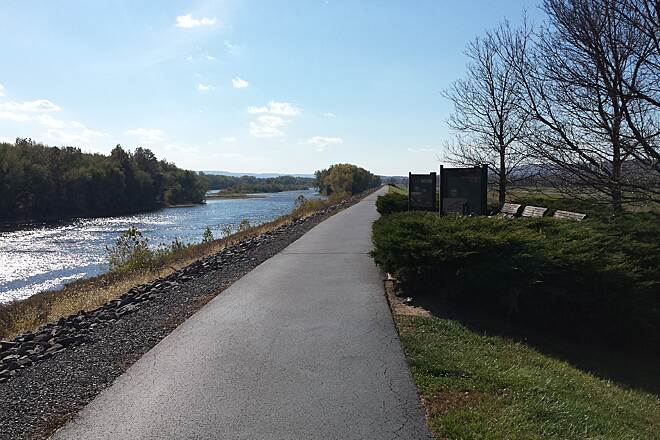 Luzerne County Levee Trail Airport right, River left The trail in Wyoming with a view of the Susquehanna River on the left and the Wyoming Valley Airport behind the benches on the right.