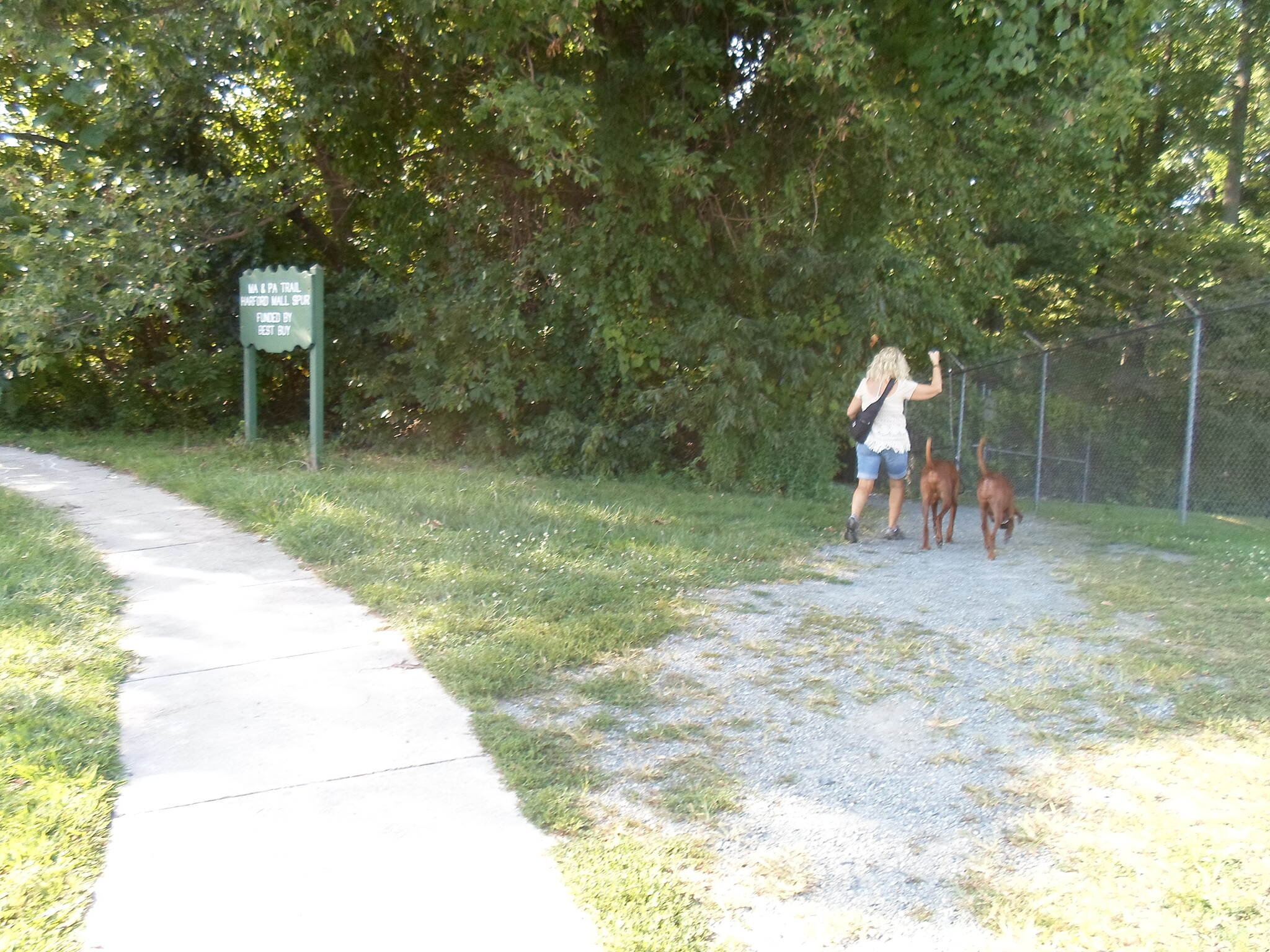 MA & PA Heritage Trail Ma & Pa Heritage Trail This woman and her dogs were accessing the trail via the branch path from Harford Mall. Taken Aug. 2014.