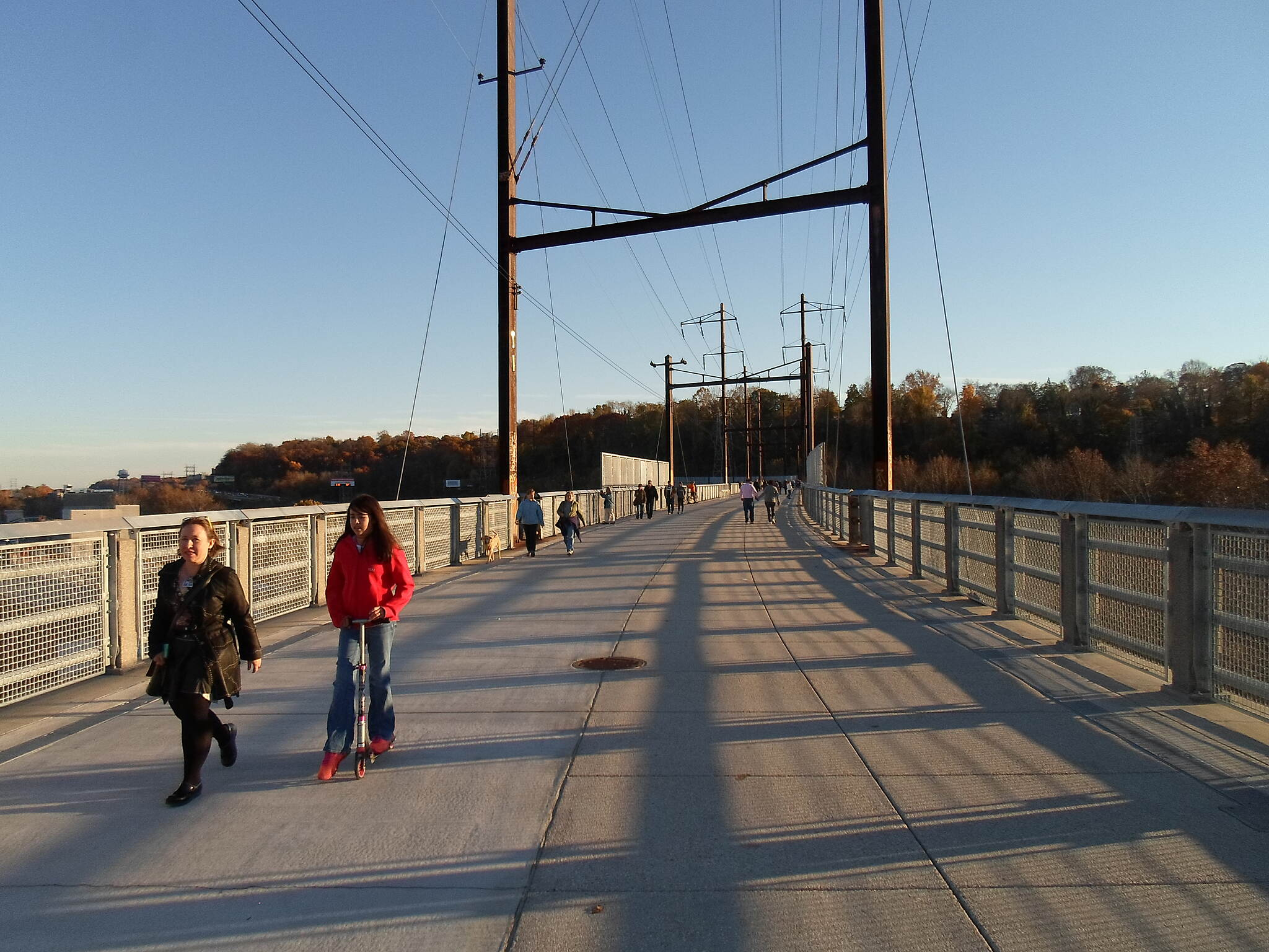Manayunk Bridge Trail Manayunk Bridge Trail This woman and her daughter were enjoying the warm, autumn evening by walking, and riding a scooter, respectively, near the Manayunk side of the trestle. Taken Nov. 2015.
