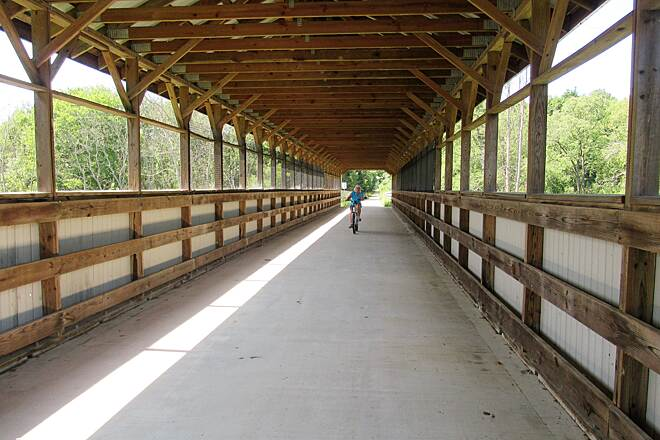 Maple Highlands Trail Inside one of the covered bridges A rider comes through one of the covered bridges