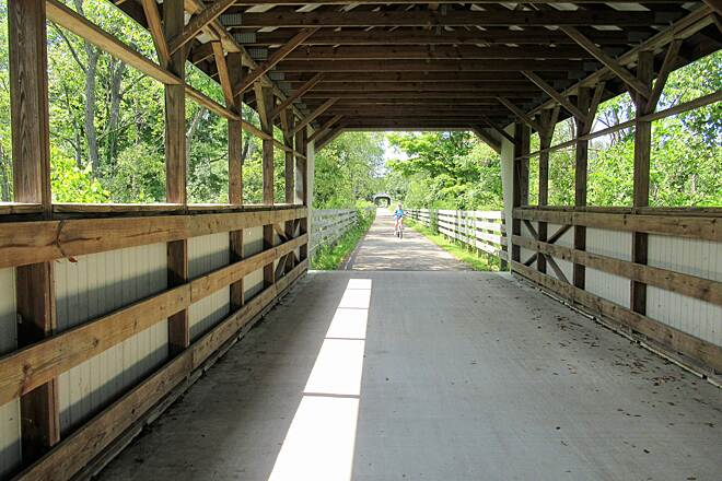 Maple Highlands Trail A rider enjoys the summer day along the trail-2018 Nice trail with 5 covered bridges