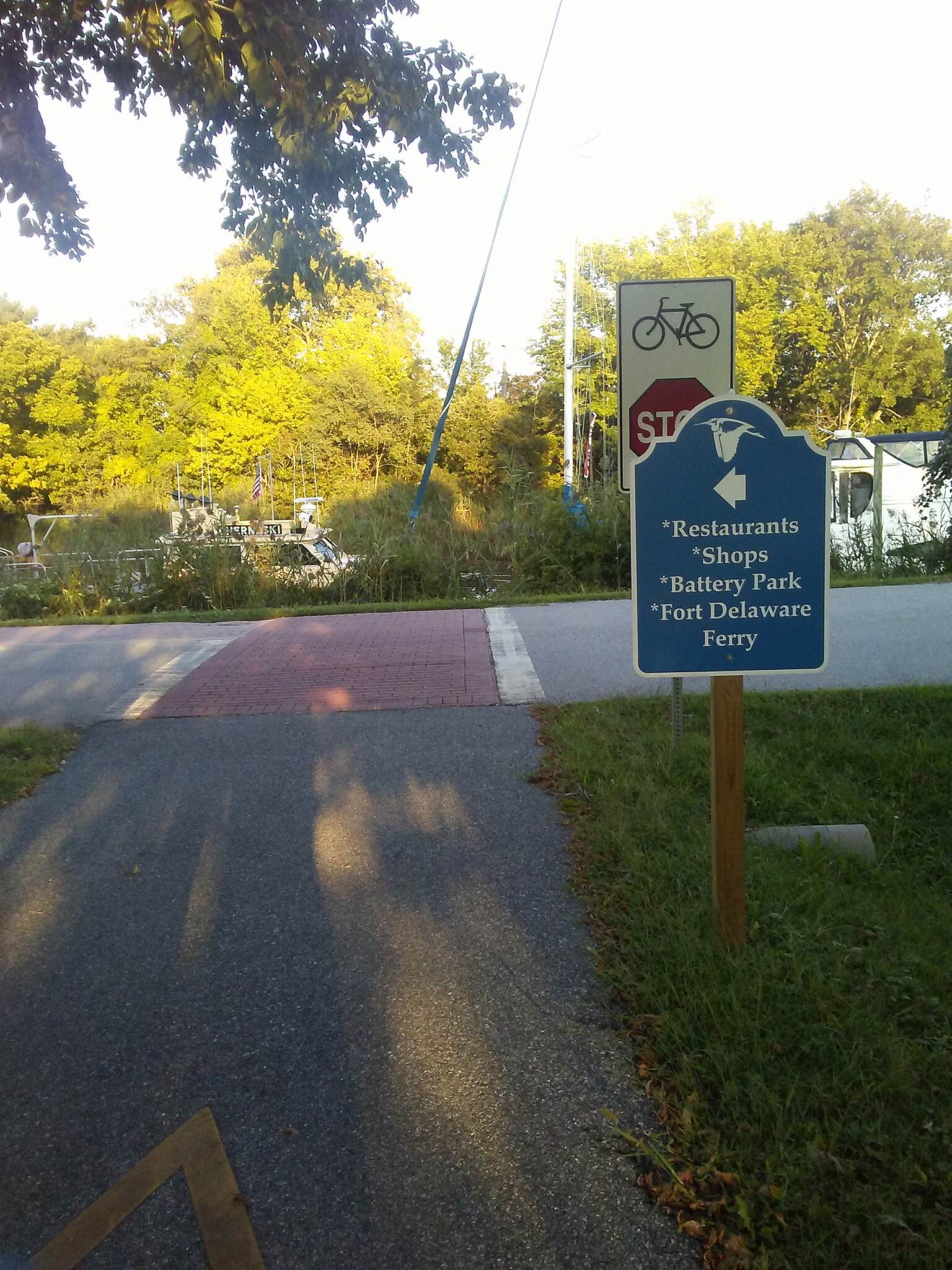 Michael Castle Trail Michael Castle Trail Sign at the junction of Canal Street informing trail users to continue east along the brick walk segment of the trail into downtown Delaware City.